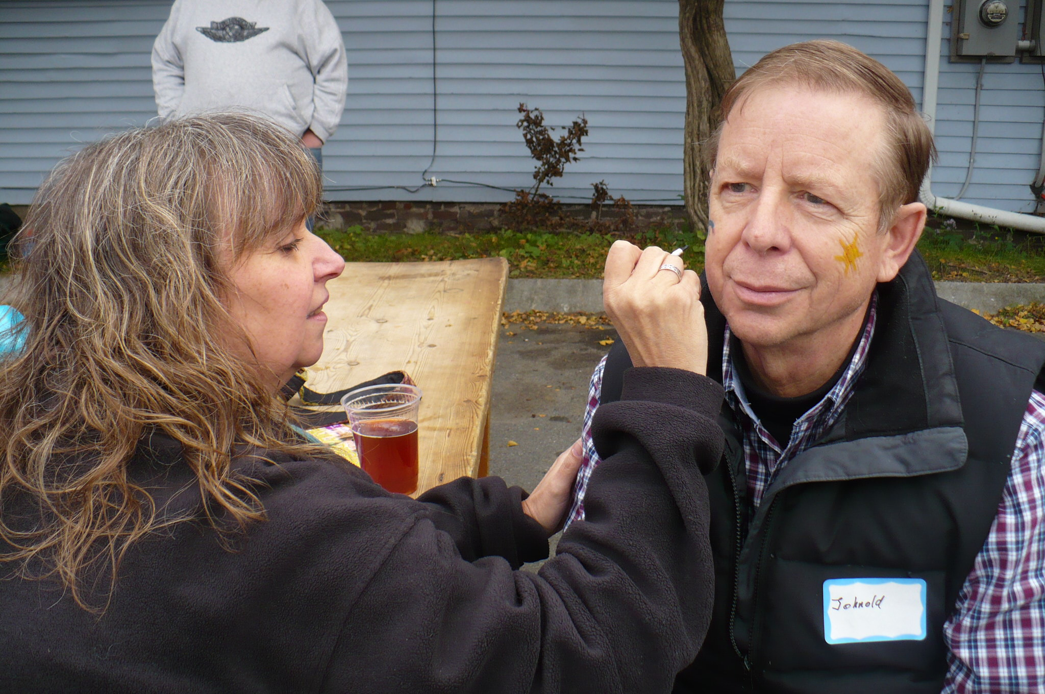 John Hanold getting his face painted